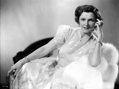 Irene Castle sitting in a Shining Gown with White Furry Shawl Photo by  Movie Star News