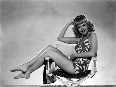 Joyce Compton sitting on a Beach Chair wearing a One Piece Bikini in a Classic Portrait Photo by  Movie Star News