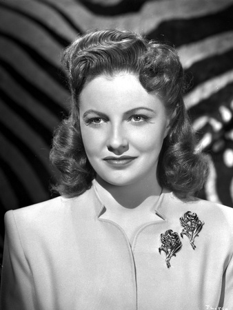 Joan Leslie on a Dress with Brooch and smiling Photo by  Movie Star News