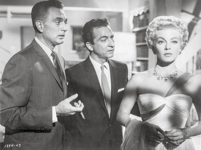 Imitation Of Life Lady in Gown with Men Talking in Suit and Tie Photo by  Movie Star News