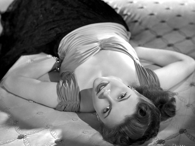 Joan Leslie Lying on Bed in a Silk Top Photo by  Movie Star News
