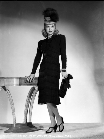 Joyce Compton wearing a Black Dress with Matching Hat and a Gloves in a Classic Portrait Photo by  Movie Star News