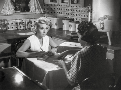 Imitation Of Life Lady Talking on Table Photo by  Movie Star News