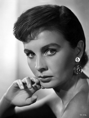 Jean Simmons Portrait in Black Off Shoulder Dress and Coin Earrings with Right Hand on the Chin Photo by  Movie Star News