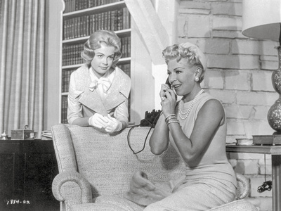 Imitation Of Life Lady in Pearl Necklace Talking on Phone with a Child Photo by  Movie Star News