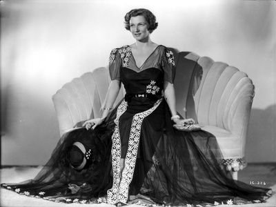 Irene Castle sitting on a Couch in Gown Photo by  Movie Star News