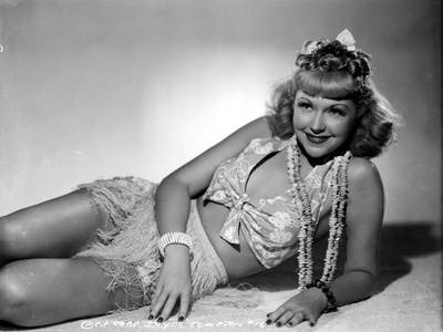 Joyce Compton Lying on the Ground and wearing a Two Piece in a Classic Portrait Photo by  Movie Star News