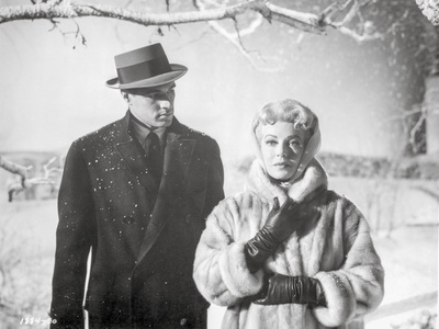 Imitation Of Life Lady in Furry Coat with Man in Black Suit with Hat Photo by  Movie Star News
