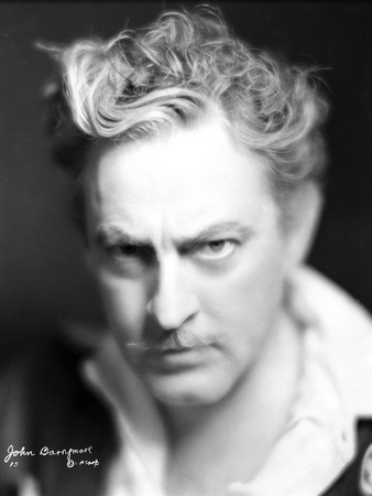 John Barrymore wearing a Black Shot and a White Undershirt in a Close Up Portrait Photo by  Movie Star News!