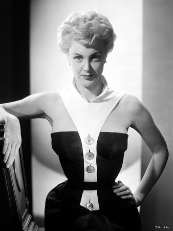 Jan Sterling Portrait in White Collar Neck Strap Black Velvet Shoulder Dress with Left Hand on the  Photo by  Movie Star News