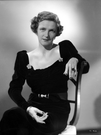 Irene Castle sitting and posed on Chair in Black Dress Photo by  Movie Star News