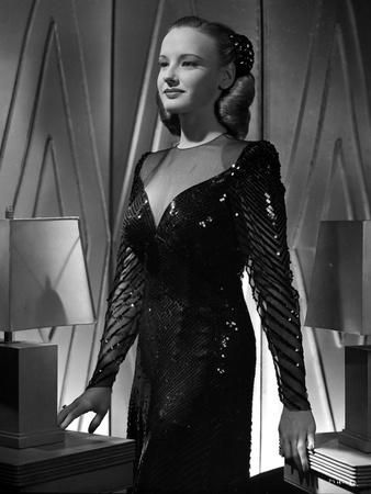 Martha Holliday Shiny V-neck Dress and standing Portrait Photo by  Movie Star News