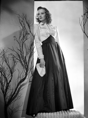 Martha Holliday on a Silk Long Sleeve Dress and Leaning on Wall Portrait Photo by  Movie Star News