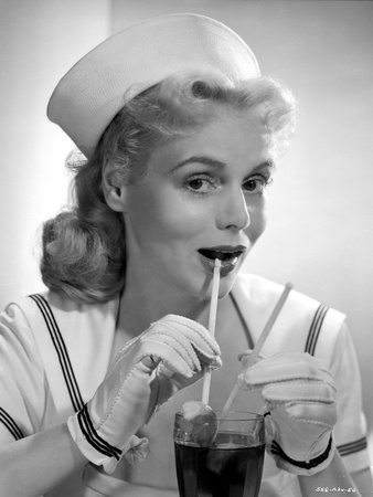 Marie Wilson Drinking a Juice in White Sailor Dress with Gloves Photo by  Movie Star News