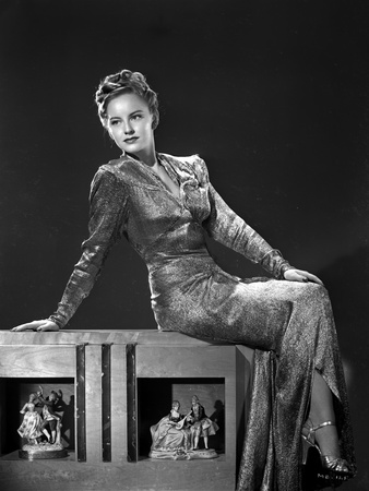 Mimi Berry sitting in Black and White Photo by  Movie Star News