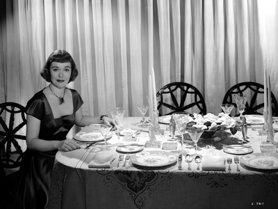 Jane Wyman Seated on the Chair in Black Velvet Short Sleeve Square-Neck Dress and Black Necklace wi Photo by  Movie Star News
