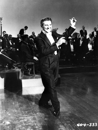 Liberace smiling in Black Suit With Piano Photo by  Movie Star News
