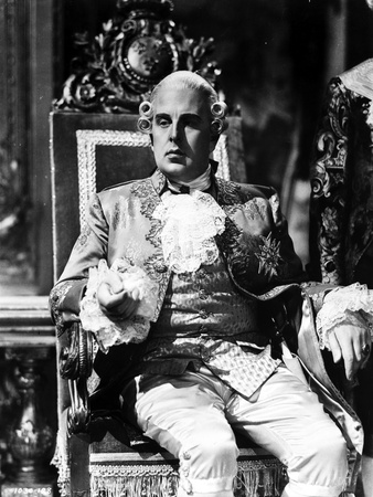 Robert Morley sitting in Classic Photo by  Movie Star News