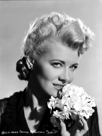 Penny Singleton smiling with Flower Close Up Portrait Photo by  Movie Star News