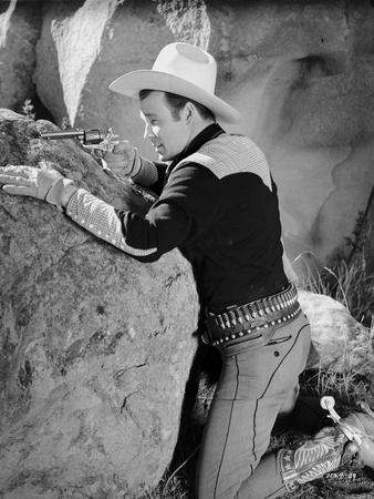 Roy Rogers Pointing A Gun with Cowboy Outfit in Black and White Photo by  Movie Star News