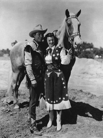 Roy Rogers posed with Girl and A Horse in Black and White Photo by  Movie Star News