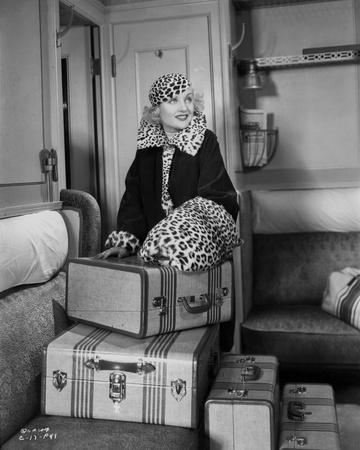 Gina Lollobrigida Opening Suitcase in Black Coat Photo by Irving Lippman