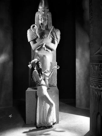 Zita Johann Leaning on Statue, wearing Sexy Dress Photo by  Movie Star News