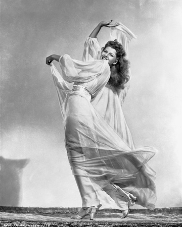 Rita Hayworth wearing a Gown with a Daring Pose Photo by Robert Coburn