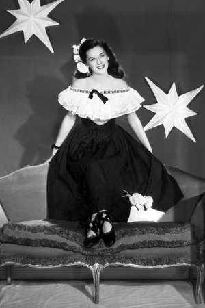 Dorothy Ford on a Off-Shoulder Dress on a Couch Photo by  Movie Star News