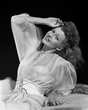 Rita Hayworth smiling in See-Through Blouse Photo by Robert Coburn