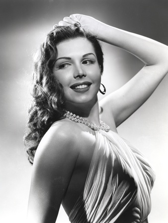 Ann Miller wearing a Dress and a Beaded Necklace in a Classic Portrait Photo by  Movie Star News