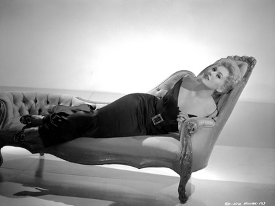 Kim Novak Lying on Bench in Black Gown Black and White Photo by  Movie Star News
