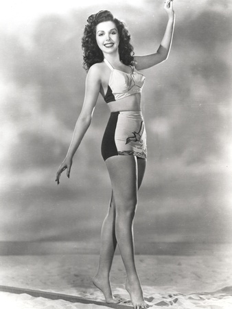 Ann Miller standing on the Sand in a Classic Portrait Photo by  Movie Star News