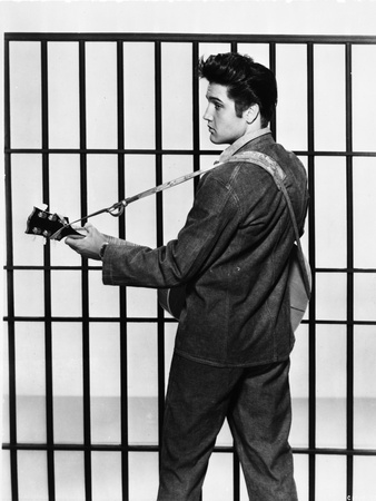 Elvis Presley Looking Back and Playing Guitar in Classic Photo by  Movie Star News