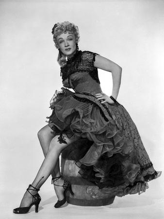 Marlene Dietrich sitting on a Barrel wearing Black Dress Photo by  Movie Star News