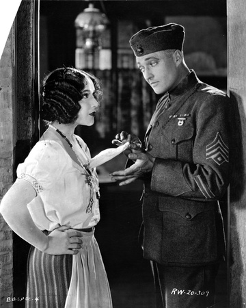 Renee Adoree Talking to a Man on an Acting Scene Photo by  Movie Star News