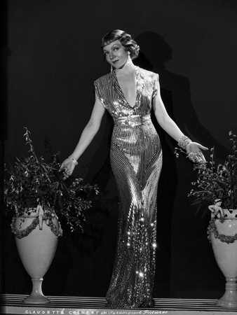 Claudette Colbert standing in Glossy Dress with Palms Open Photo by  Hurrell