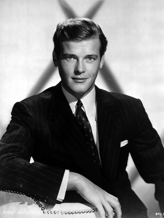 Movie Star News, young Roger Moore dressed in sharp black suit with white background, black and white celebrity photo
