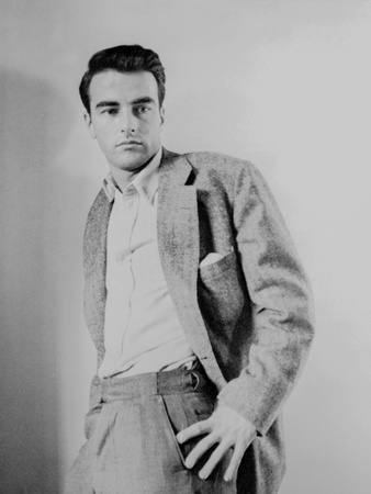 Montgomery Clift Leaning on a Wall wearing Suit Photo by  Movie Star News