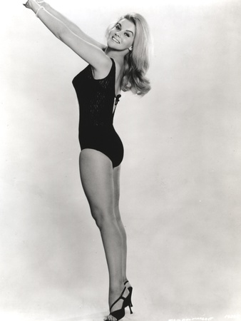 Ann Margret Stretching While Taking a Picture Photo by  Movie Star News