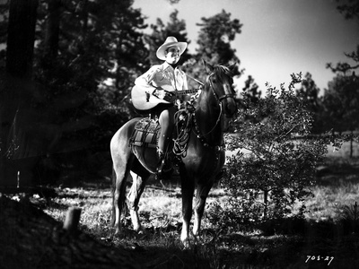 Gene Autry Riding a Horse and Carying a Guitar Photo by  Movie Star News