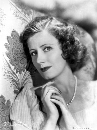 Irene Dunne on a Dress wearing Pearl Necklace Photo by  Movie Star News