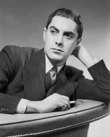 Tyrone Power Leaning on Couch Black and White Photo by  Movie Star News