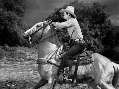 Roy Rogers Riding A Horse in Black and White Photo by  Movie Star News