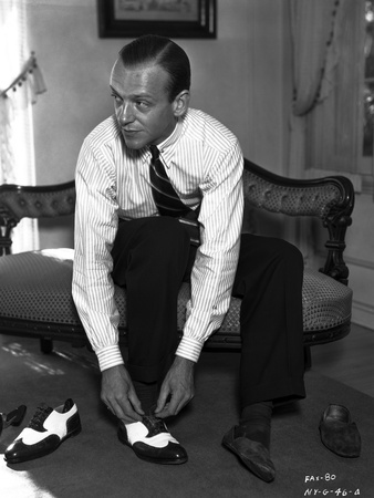 Fred Astaire Seated on Couch while wearing Shoe Photo by  Hendrickson