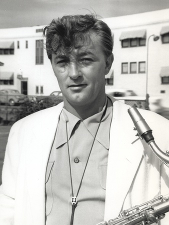 Robert Mitchum Carrying a Musical Instrument Photo by  Movie Star News