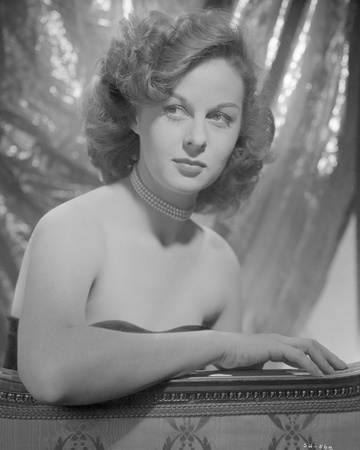 Susan Hayward sitting on a Black Tube Dress Photo by  Movie Star News