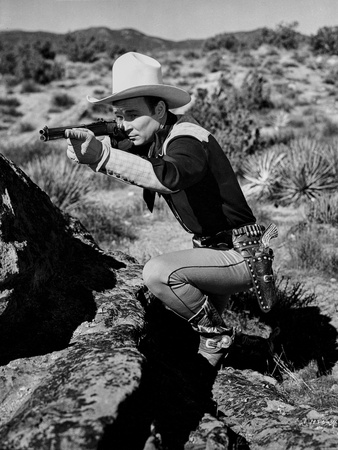 Roy Rogers Pointing A Gun with Cowboy Outfit Photo by  Movie Star News