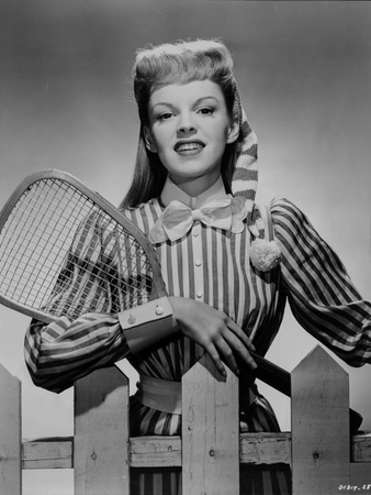 Judy Garland striped shirt and tennis racket Photo by  Movie Star News