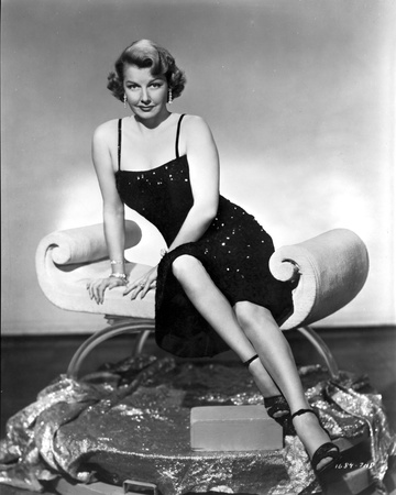 Ann Sheridan sitting Elegantly on the Chair Photo by  Movie Star News